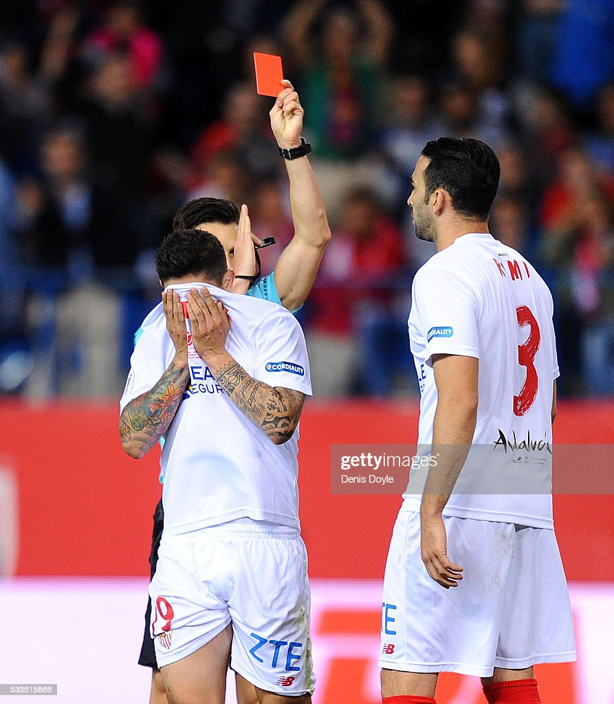 Ever Banega of Sevilla reacts while getting the red card by Referee Carlos del Cerro Grande during the Copa del Rey Final between Barcelona and Sevilla at Vicente Calderon Stadium on May 22, 2016 in Madrid, Spain.
