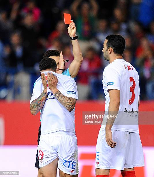 Ever Banega of Sevilla reacts while getting the red card by Referee Carlos del Cerro Grande during the Copa del Rey Final between Barcelona and...