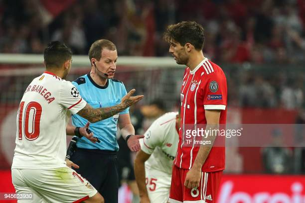 Ever Banega of Sevilla speaks with Referee William Collum and Javi Martinez of Muenchen during the UEFA Champions League quarter final second leg...