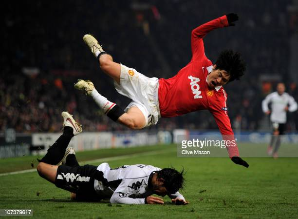 Ever Banega of Valencia brings down JiSung Park of Manchester United during the UEFA Champions League Group C match between Manchester United and...