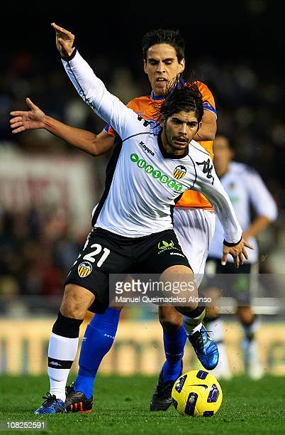 Ever Banega of Valencia duels for the ball with Recio of Malaga during the La Liga match between Valencia and Malaga at Estadio Mestalla on January...