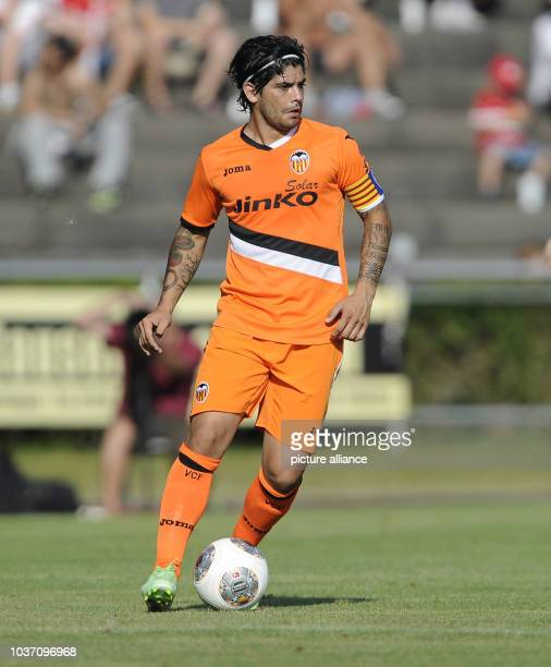 Ever Banega of Valencia plays the ball during the test match VfB Stuttgart vs FC Valencia in the LudwigJahnStadion in Ludwigsburg Germany 20 July...