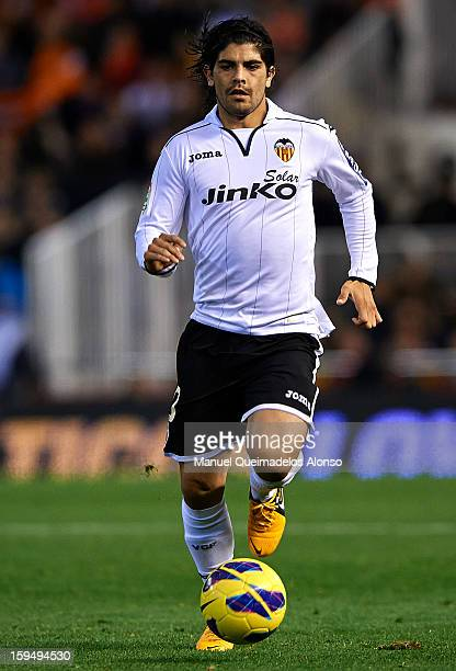 Ever Banega of Valencia runs with the ball during the La Liga match between Valencia and Sevilla at Estadio Mestalla on January 12 2013 in Valencia...