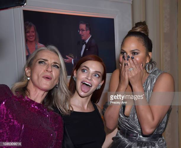 Ever Carradine Madeline Brewer and Chrissy Teigen attend Hulu's 2018 Emmy Party at Nomad Hotel Los Angeles on September 17 2018 in Los Angeles...