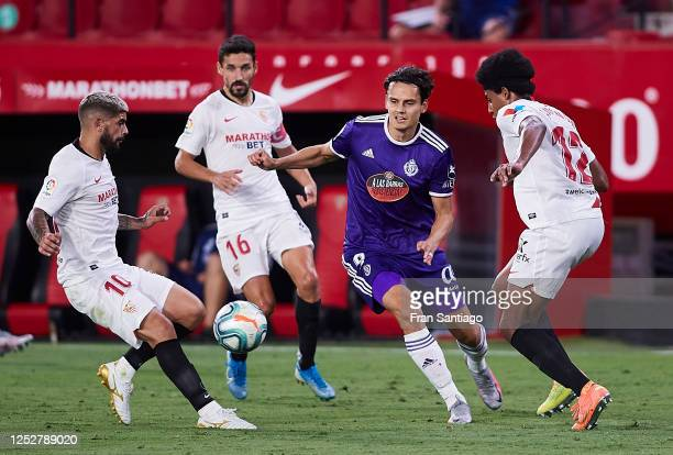 Ever Maximiliano Banega Kounde and Jesus Navas Gonzalez of Sevilla FC compete for the ball with Enes Unal of Valladolid CF during the Liga match...