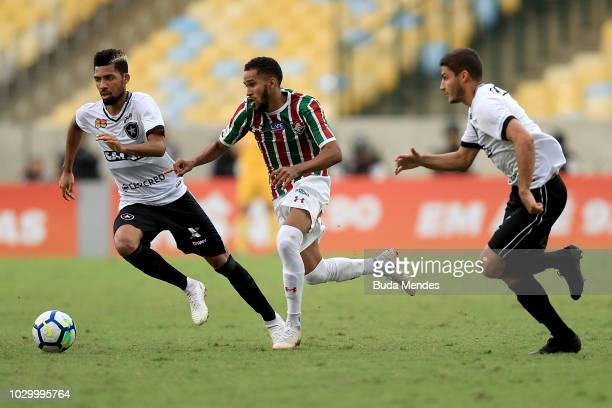Everaldo of Fluminense competes for the ball with Matheus Fernandes and Marcinho of Botafogo during a match between Fluminense and Botafogo as part...
