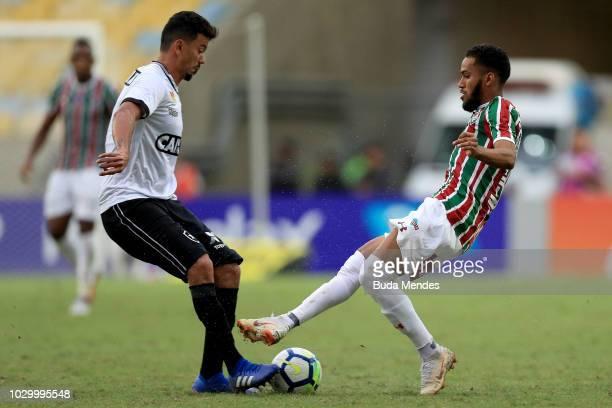Everaldo of Fluminense competes for the ball with Rodrigo Lindoso of Botafogo during a match between Fluminense and Botafogo as part of Brasileirao...