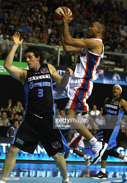 Everard Bartlett of the 36'ers shoots under pressure from Daryl Corletto of the Breakers during the round 15 NBL match between the New Zealand...