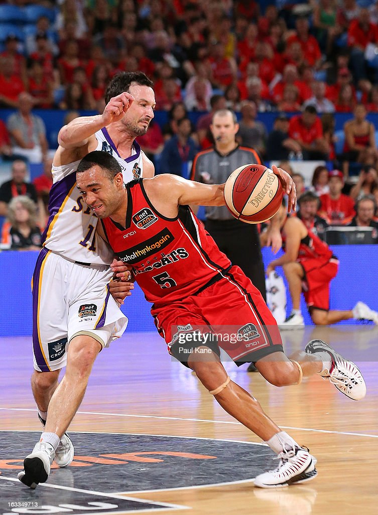 Everard Bartlett of the Wildcats drives to the basket against Aaron Bruce of the Kings during the round 22 NBL match between the Perth Wildcats and the Sydney Kings at Perth Arena on March 8, 2013 in Perth, Australia.