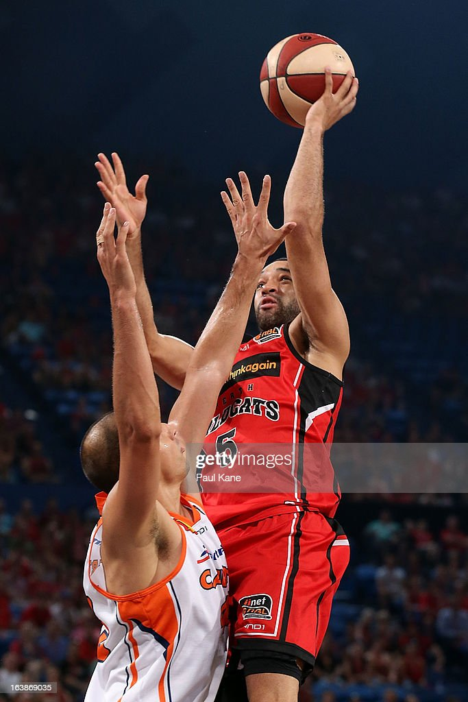 Everard Bartlett of the Wildcats shoots against Dusty Rychart of the Taipans during the round 23 NBL match between the Perth Wildcats and the Cairns Taipans at Perth Arena on March 17, 2013 in Perth, Australia.