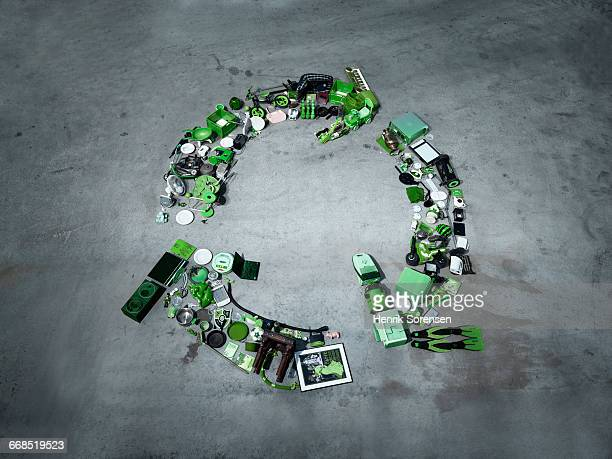 Everday objects forming a recycle symbol