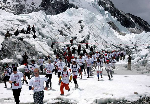 Marathon runners run under a banner at the start of the 'Everest Hillary Marathon' at Everest Base Camp 29 May 2006 Over 140 marathon runners took...