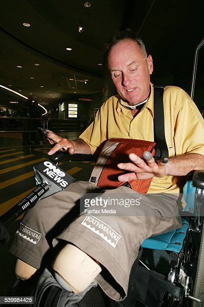 Everest conqueror and double amputee Mark Inglis shows his frost bitten fingers as he arrives at Auckland airport 25 May 2006 DMP Picture by JOHN...