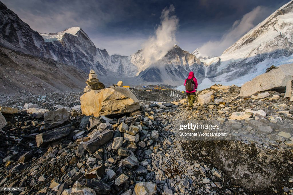 Everest Trekkers walking up to the top of the mountain. : Stock Photo