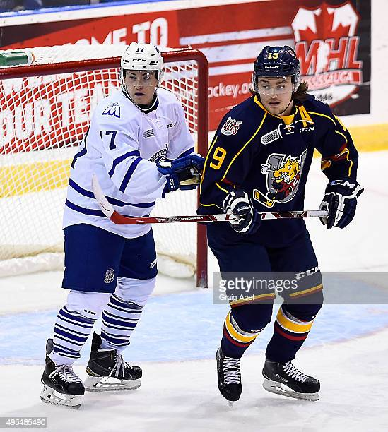 Everett Clark of the Mississauga Steelheads fights for crease space with Rasmus Andersson of the Barrie Colts during OHL game action on November 1...