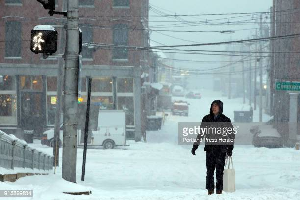Everett Coulter of Portland pauses to check the traffic signals at the intersection of Fore and Pearl streets on Wednesday