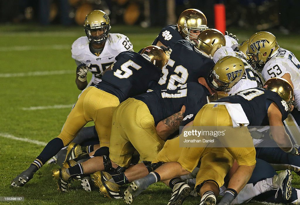 Everett Golson #5 of the Notre Dame Fighting Irish follows blockers into the end zone to score the game-winning touchdown against the Pittsburgh Panthers at Notre Dame Stadium on November 3, 2012 in South Bend, Indiana. Notre Dame defeated Pittsburgh 29-26 in triple overtime.