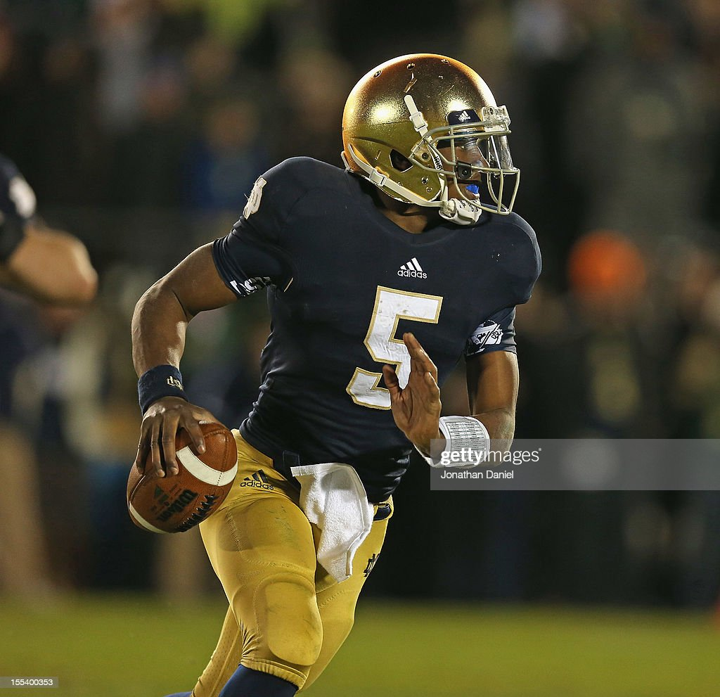 Everett Golson #5 of the Notre Dame Fighting Irish rolls out before throwing a touchdown pass against the Pittsburgh Panthers at Notre Dame Stadium on November 3, 2012 in South Bend, Indiana. Notre Dame defeated Pittsburgh 29-26 in triple overtime.