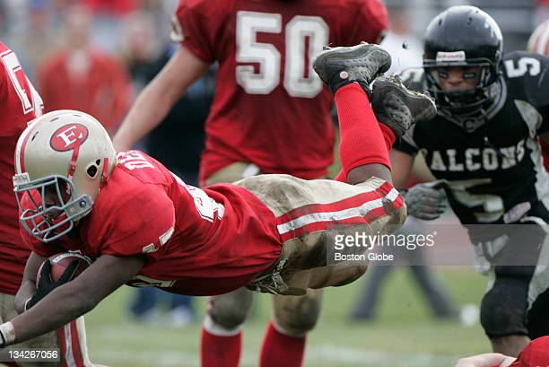 Everett High School running back Patrick Deleon dives to score a second half touchdown against Cambridge during a Thanksgiving Day game played at...