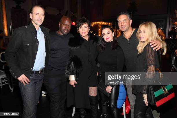 Everett Jack Corey Gamble Kris Jenner Kyle Richards Mauricio Umansky and Faye Resnick pose for a photo as Remy Martin celebrates Tristan Thompson's...