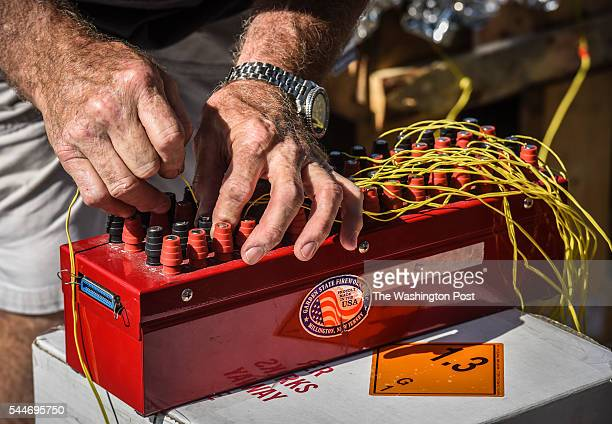 Everett Seemann of Garden State Fireworks hooks up the electronics as they work to ready the pyrotechnics planned for the National Mall this coming...