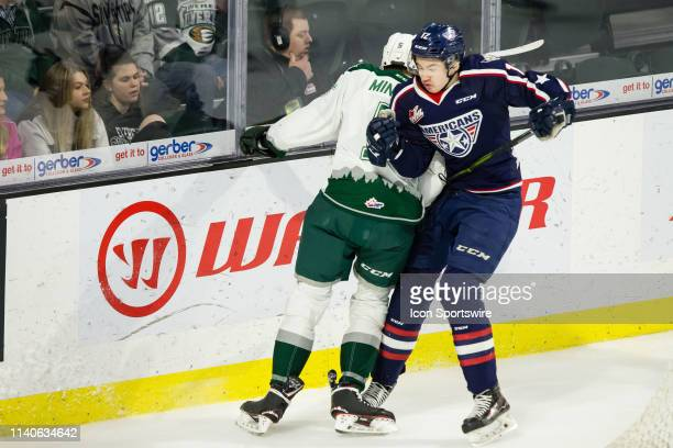Everett Silvertips defenseman Artyom Minulin and TriCity Americans forward Samuel Huo collide along the wall in the first period during Game 5 of the...
