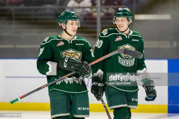 Everett Silvertips defenseman Gianni Fairbrother and forward Robbie Holmes have a laugh before the third period puck drop during a game between the...