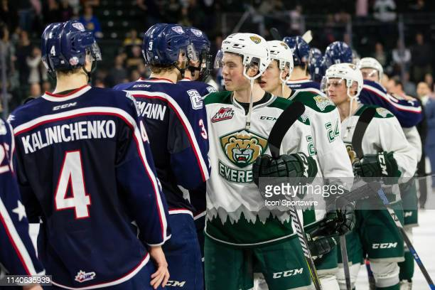 Everett Silvertips defenseman Jake Christiansen shakes hands with TriCity Americans defenseman Dom Schmiemann after Game 5 of the divisional playoff...
