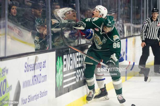 Everett Silvertips defenseman Sahvan Khaira checks a Spokane Chiefs player against the boards in the second period during a game between the Spokane...