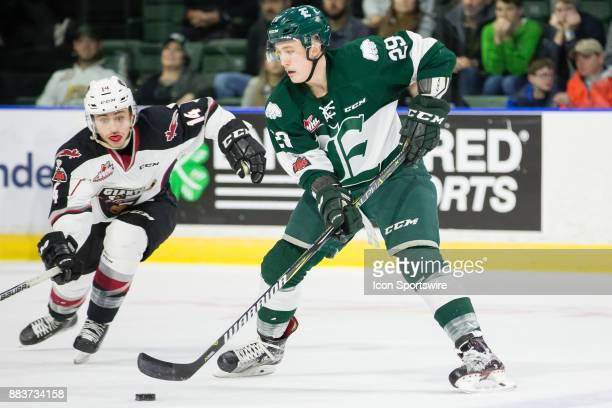 Everett Silvertips defenseman Wyatte Wylie keeps the puck out of reach from Vancouver's James Malm during a game between the Vancouver Giants and the...