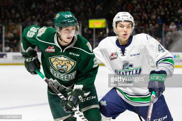 Everett Silvertips forward Gage Goncalves and Seattle Thunderbirds defenseman Zachary Ashton battle for position at center ice during a game between...