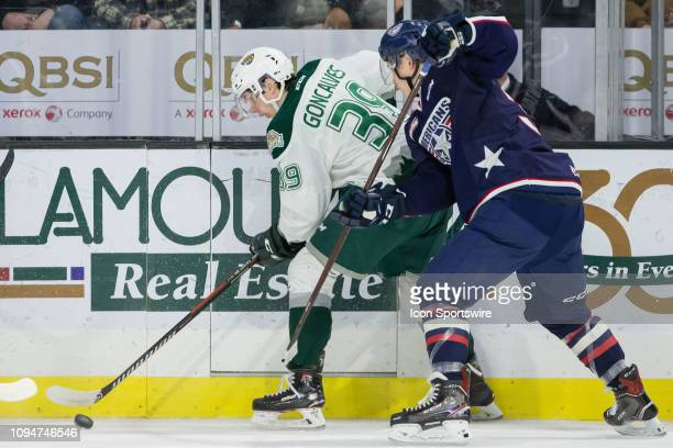 Everett Silvertips forward Gage Goncalves shields the puck from an opposing TriCity Americans player along the boards during a game between the...