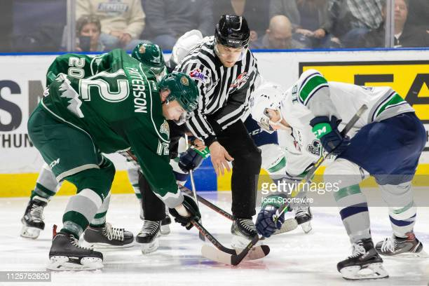 Everett Silvertips forward Max Patterson takes a faceoff against Seattle Thunderbirds forward Noah Philp in the third period during a game between...