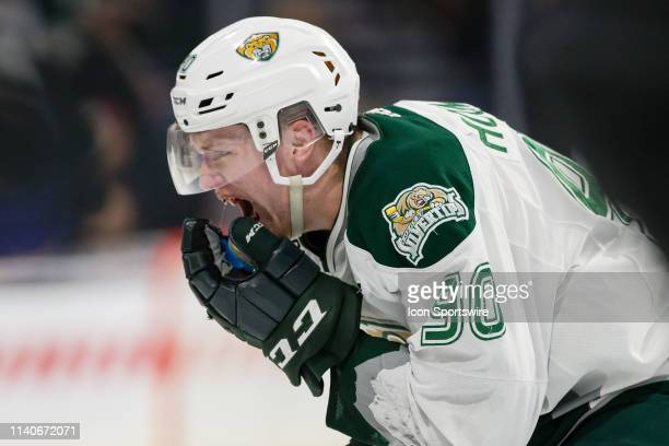 Everett Silvertips forward Robbie Holmes skates straight to the dressing room after getting hit in the mouth with the puck during Game 2 of the...
