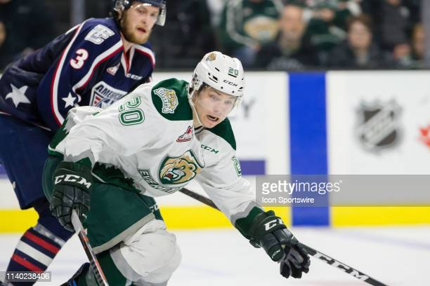 Everett Silvertips forward Zack Andrusiak shields TriCity Americans defenseman Dom Schmiemann from the puck during Game 1 of the divisional playoff...