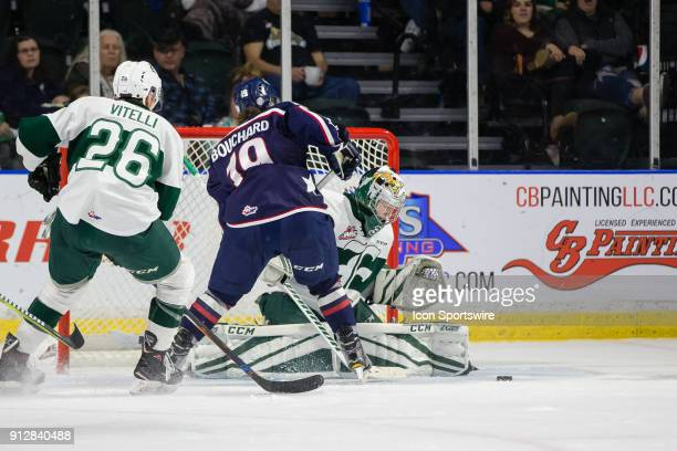 Everett Silvertips goaltender Dustin Wolf makes a pad save on TriCity Americans forward Connor Bouchard during the third period in a game between the...