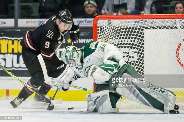 Everett Silvertips goaltender Dustin Wolf stops a shot from Red Deer Rebels forward Jeff De Wit at the side of his net in the second period during a...