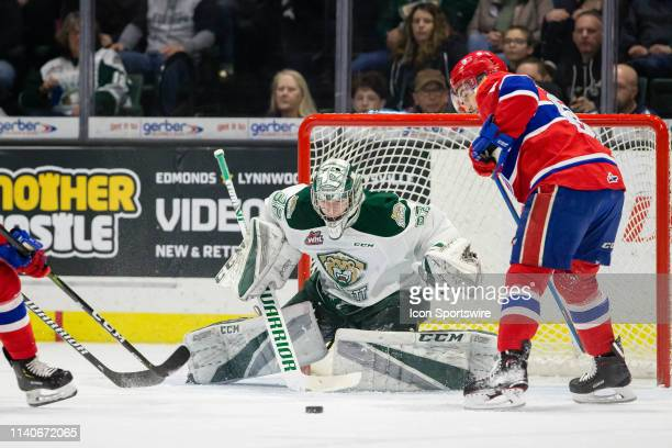 Everett Silvertips goaltender Dustin Wolf watches a puck slide wide in front of him during Game 2 of the playoff series between the Everett...
