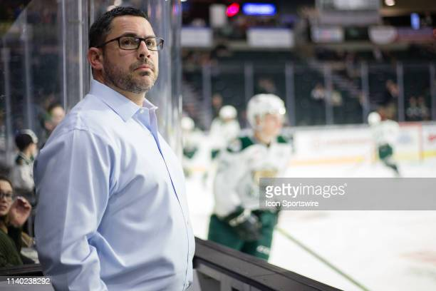 Everett Silvertips head coach Dennis Williams watches warm ups from the bench before Game 1 of the divisional playoff series between the Everett...