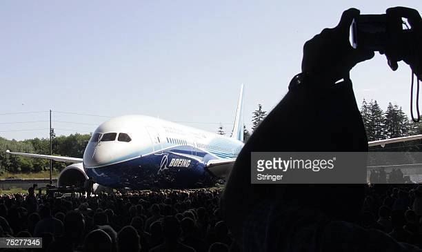 A member of the public gets a picture of the new Boeing 787 Dreamliner as it appears to the crowd during the world premiere of this aircraft in...