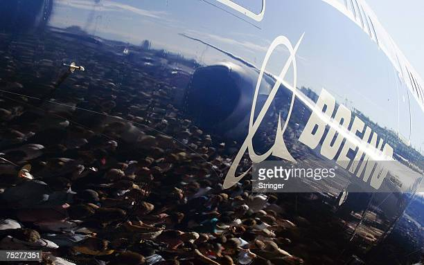 The image of the crowd mirrors on the fuselage of the Boeing 787 Dreamliner during the world premiere of this aircraft in Everett Washington 08 July...