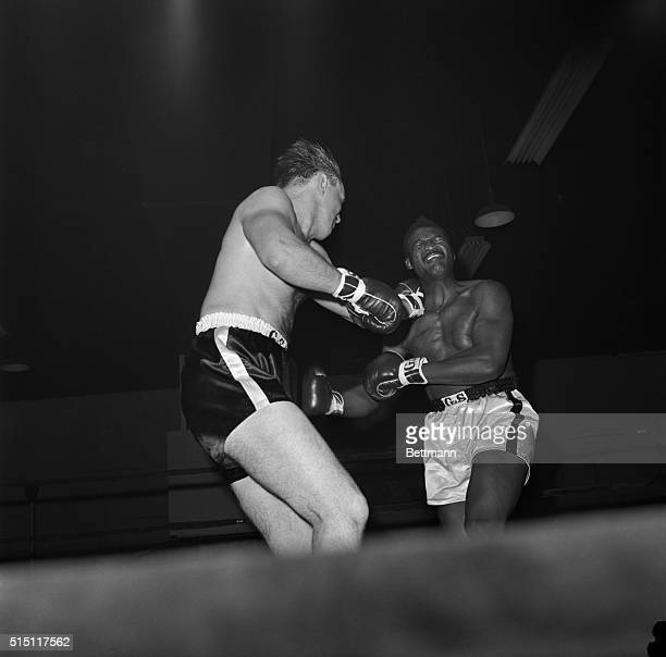 Everette Copeland of Brooklyn grimaces as Chuck Wepner of Bayonne NJ scores with a left during their sixround feature bout at Sunnyside Garden in...