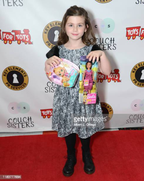 Everleigh McDonell attends The Couch Sisters 1st Annual Toys For Tots Toy Drive held onNovember 20 2019 in Glendale California