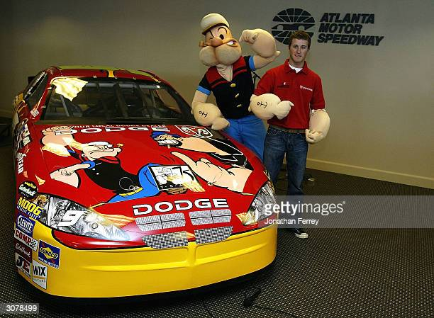 Evernham Motorsports driver Kasey Kahne poses with Popeye at the unveiling of his Dodge Dealers UAW Popeye Dodge during practice for the NASCAR...
