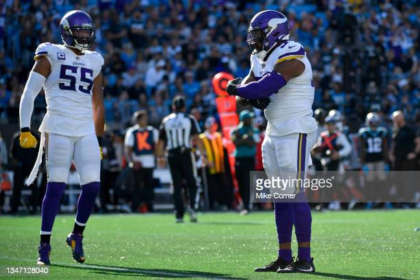 Everson Griffen and Anthony Barr of the Minnesota Vikings celebrate after forcing a fumble during the fourth quarter against the Carolina Panthers at...