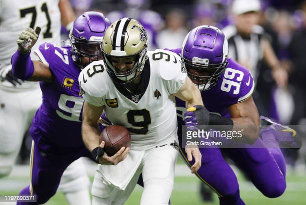 Everson Griffen and Danielle Hunter of the Minnesota Vikings sack Drew Brees of the New Orleans Saints during the first quarter in the NFC Wild Card...