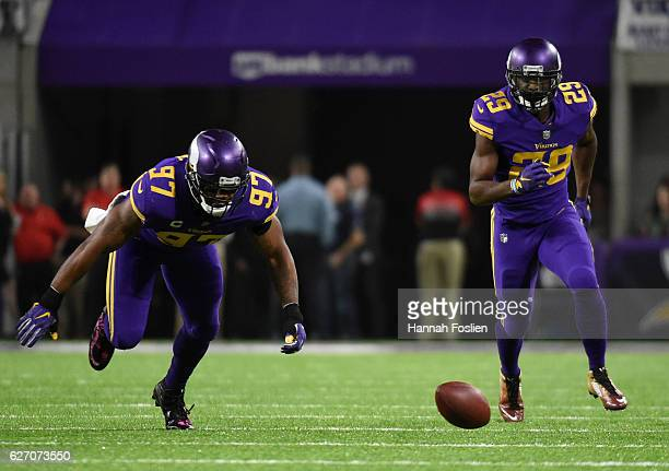 Everson Griffen of the Minnesota Vikings and Xavier Rhodes scramble for a loose ball after a fumble in the second quarter of the game on December 1...
