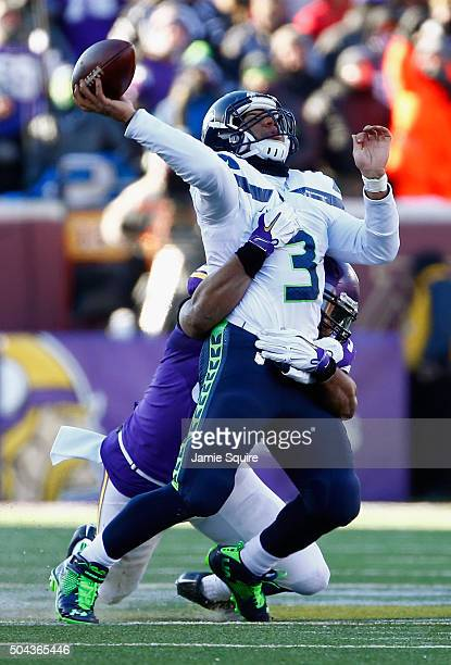 Everson Griffen of the Minnesota Vikings attempts to tackle Russell Wilson of the Seattle Seahawks in the fourth quarter during the NFC Wild Card...