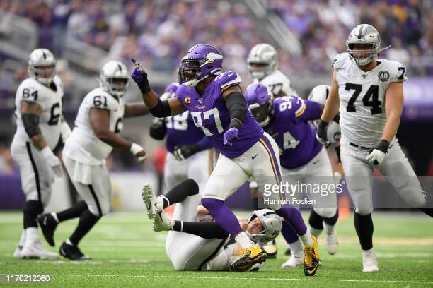 Everson Griffen of the Minnesota Vikings celebrates a sack of quarterback Derek Carr of the Oakland Raiders during the second quarter of the game at...