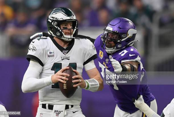 Everson Griffen of the Minnesota Vikings puts pressure on quarterback Carson Wentz of the Philadelphia Eagles during the second quarter of the game...